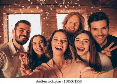 Close up photo gathering friends event hang out drunk people make take selfies show v-sign night life festive she her ladies he him his guys wear dress shirts formal wear glitter loft room indoors
