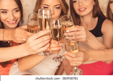Close up photo of girls celebrating a bachelorette party and clinking