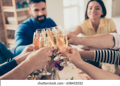 Close up photo of glasses with champagne. Young people are toasting to celebrate the event together