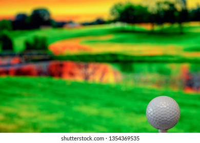 Close up photo of a golf ball in the golf course in a warm sunset light. Extremely shallow depth of field, focus on the golf ball. Copy space on the left half of the photo.