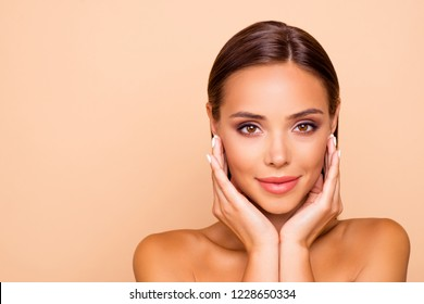 Close up photo of good-looking cute nice lovely lady with naked shoulders touch her face by hands isolated on pastel beige background with copy space for text
