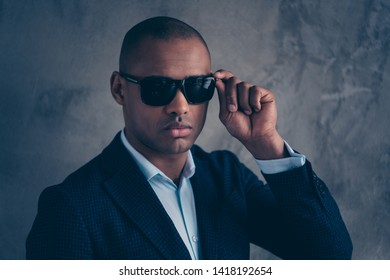 Close up photo of gorgeous boss chairman touch fashionable specs serious gentlemen focused short hair bald concentrated ready have modern clothing isolated grey background