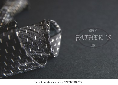 Close - up photo gray men's tie. Father's day inscription for the holiday