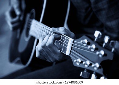 Close up photo of guitar player. Black and white photo