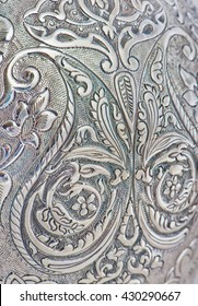 Close up photo of handmade silverware that is delicately handcrafted, silver handicrafts, Custom made authentic designs are the key factor in getting the fine art made. Decorative silver vase