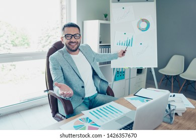 Close up photo handsome he him his boss chief guy showing new statistics stats numbers income marketing investment tell colleagues news novelty strategy notebook table sit office chair wear jacket