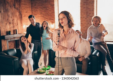 Close up photo having fun gathering best friends buddies six person karaoke night day hang out vocal soloist she her ladies he him his guys wear dresses shirts formal wear sit sofa loft room indoors
