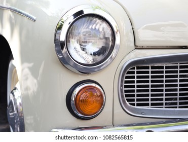 Close up photo of headlight retro car face
