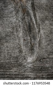 close up photo of a knot in weathered wood