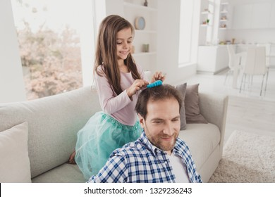 Close up photo little she her girl try hard make daddy best coiffure glad be useful he him his father sitting obediently spend sunday morning togetherness wear checkered plaid shirt house cozy divan