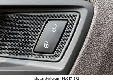 Close up photo of lock button of car doors. Closeup shot of lock and unlock buttons in car.