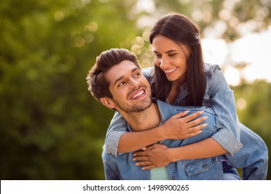 Close up photo of lovely sweethearts looking piggyback wearing denim jeans jackets outdoors