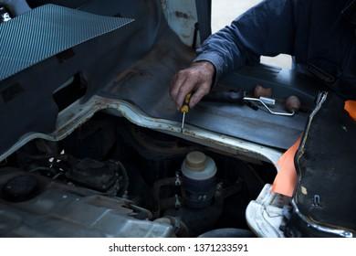 Close Up Photo Of Mechanic Repairing Car