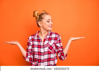 Close up photo nice she her lady perfect appearance hold open hands arms palms products look better one advising buy buyer wear casual checkered plaid pink shirt isolated bright orange background