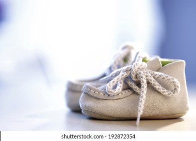 Close up photo of a pail of small slippers for toddlers