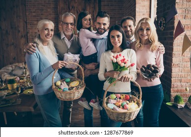 Close up photo of people gathered family cuddle each other standing portrait ready go to church with full baskets easter gladness decorations vacation funny sweet emotions happiness