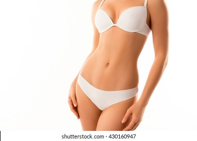 Close up photo of perfect female body isolated on white background