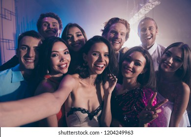 Close up photo portrait of friends cuddle to each other and take selfie on front camera of modern smartphone rest relax and chill in night club