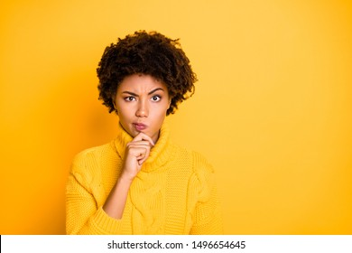Close up photo portrait of mindful full of creative thoughts interesting solutions smart clever teen girl holding hand on chin making up excuse for not to be guilty isolated vibrant color background