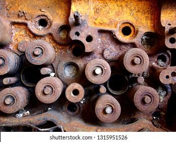 Close up photo of a rusty and broken car engine at a junkyard