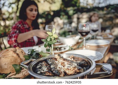 Close up photo of served grilled fish at dining table at backyard patio