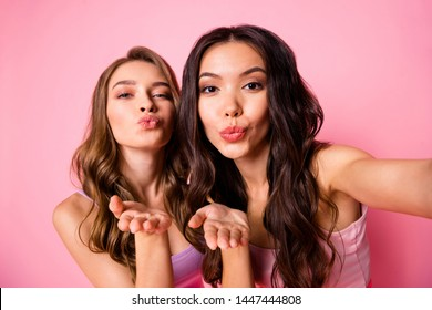 Close up photo sweet love lovers ladies romance romantic send air kisses attract boyfriends  weekend summer travel make photos video call curly hairdo clothes isolated stylish trendy pink background