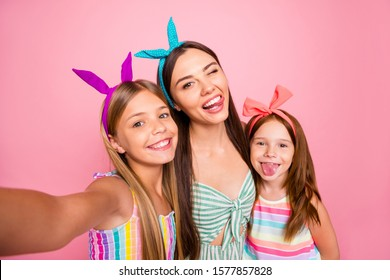 Close up photo of three people with blonde brunette long hair make selfie grimace wearing headbands skirt dress isolated over pink  background