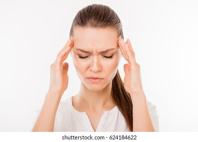 Close up photo of tired unhappy woman isolated on white background touching her temples while having a headache