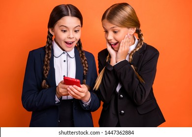 Close up photo two beautiful people she her little sisters lady hands arms cheeks telephone show instagram followers wear formalwear shirt blazer school form bag isolated bright orange background