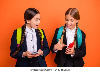 Close up photo two beautiful people she her little lady open mouth hands arms telephone reader instagram followers wear formalwear shirt blazer skirt school form bag isolated bright orange background