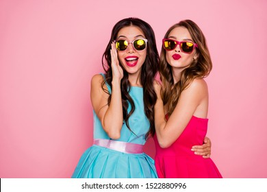 Close up photo two beautiful she her ladies foreign travelers tourism send air kiss handsome strangers coquette wear sun specs shiny colorful dresses formal-wear isolated pink rose vivid background