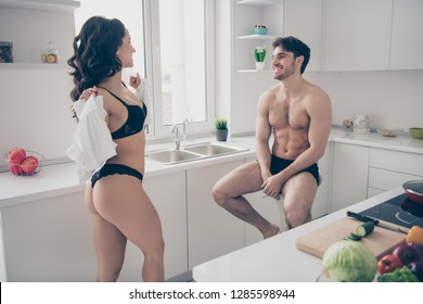 Close up photo of two people pair celebrate valentine day she her lady take he him his shirt off husband on chair lovely watching tease wife distract from cooking breakfast salad vegetables on table