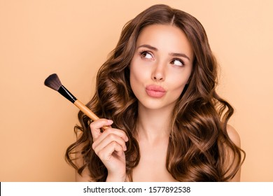 Close up photo of uncertain unsure girl hesitate hold blush blusher dont know apply powder rouge  to make visage ideal  isolated over pastel color background