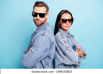 Close up photo of undercover agents spy in eyewear eyeglasses standing back to back wearing jeans denim jackets isolated over blue background