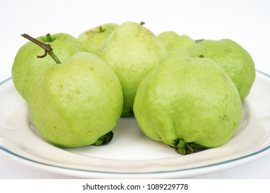 Close up of photo of very fresh green common guava (Psidium guajava) on white isolated on white background