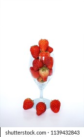 Close up of photo of very fresh harvested strawberries in champagne glass isolated on white background