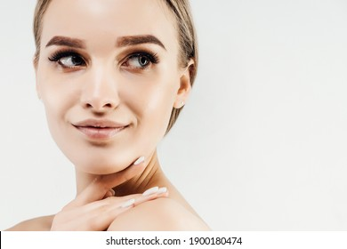 Close up photo of a woman with clean healthy skin looking to the side. Place for text.