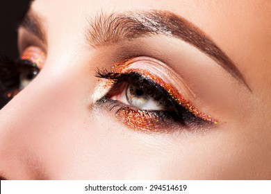 Close up photo of woman eyes with professional make up in studio