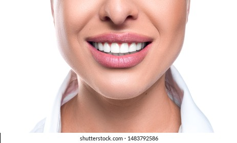 Close up photo of a woman smile on white background. Teeth whitening and dental health concept.