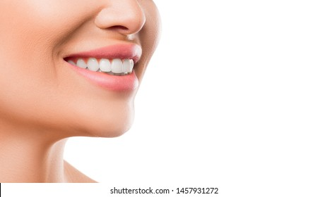 Close up photo of a woman smiling. Teeth whitening and health concept.