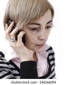 Close up photo of a woman talking on phone.