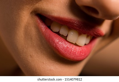 Close up photo of woman's lips with natural make up