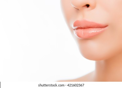 Close up photo of woman's lips with natural make up on white background