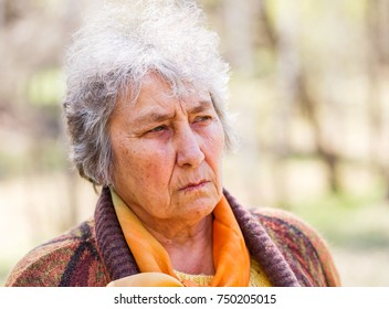 Close up photo of worried elderly woman
