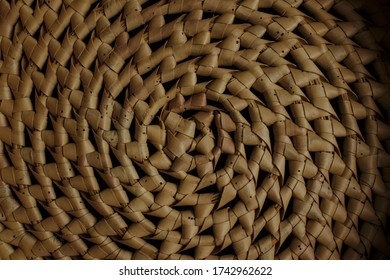 Close up photo of woven cane basket pattern with holes and damage caused by termites