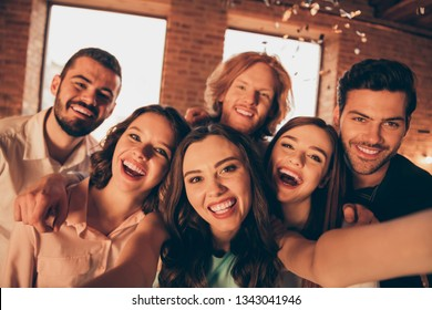 Close up photo yelling loud friends event hang out drunk six people make take selfies night life festive she her ladies he him his guys wear dress shirts formal wear glitter loft room indoors