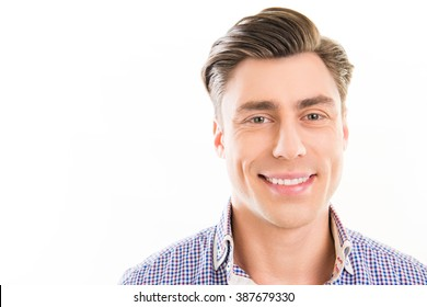 Close up photo of young happy smiling man om white background
