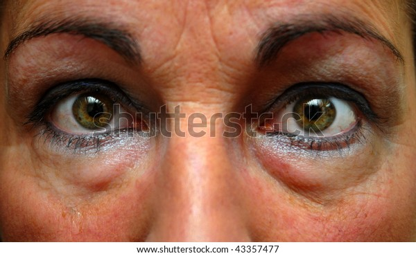 Close up photograph of in an insomniac's eyes with eyeliner on.