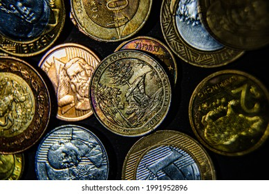 Close up photograph of several coins from different countries.