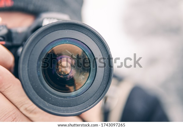 Close up of photographer with lens